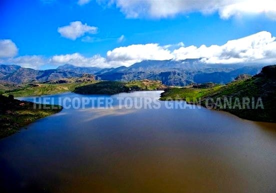 Helicopter over Gran Canaria lakes and mountains