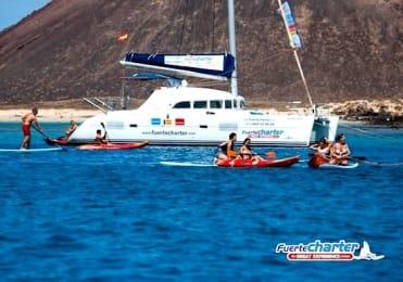 Enjoy kayaking with catamaran tour