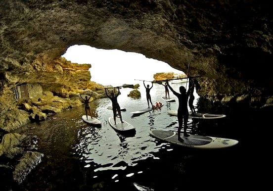 stand up paddle through coastal caves in Ibiza