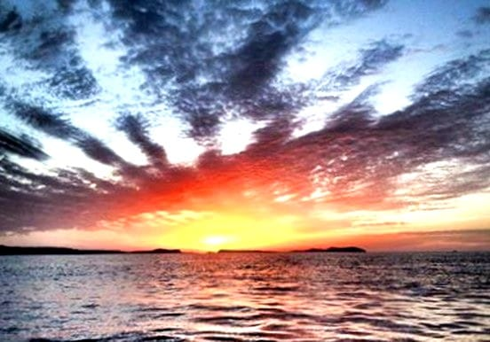 Sunset for speed boat adventure in Ibiza