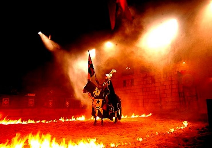 Knight on horse surrounded by fire