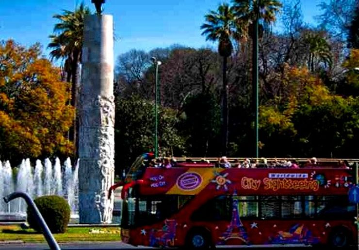 Ride the open-top sightseeing bus in Seville