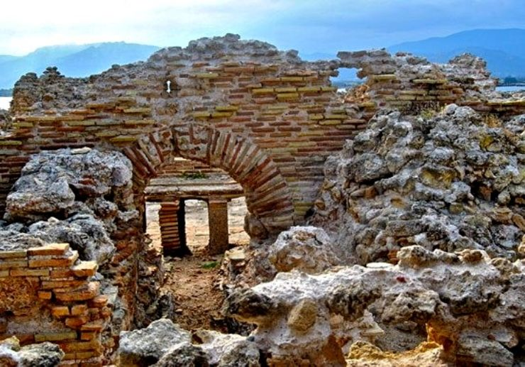 See the archeoligical sites of Nora in Sardinia