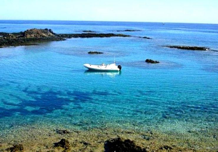 Private speedboat sailing around Lobos Island