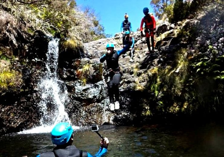 Canyoning in Madeira jumping into water ponds