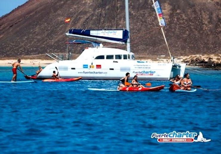 Enjoy kayaking on private catamaran tour