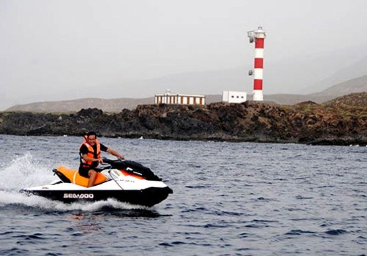Check out light house while jet skiing Tenerife
