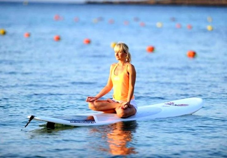 Stand up paddle yoga in Malta