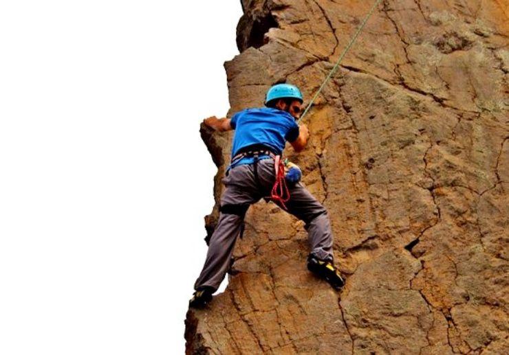 Climbing steep rocks in La Palma