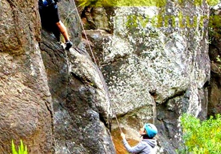 Climbing steep rock formation in La Palma