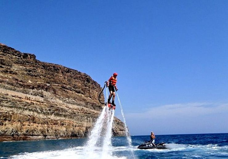 Flyboarding over water Playa Taurito