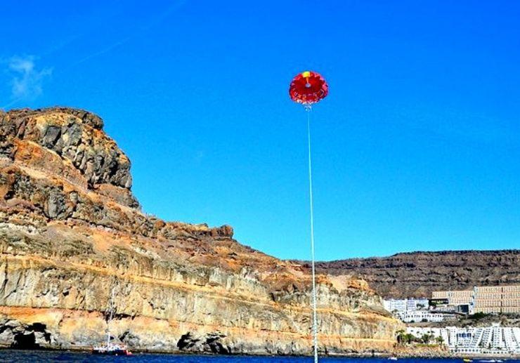 Parasailing over Gran Canaria coast like a bird