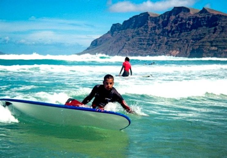 Learning to surf in the waves in Lanzarote