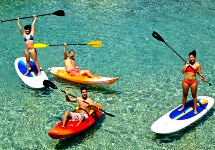 Private catamaran sailing with kayak and SUP