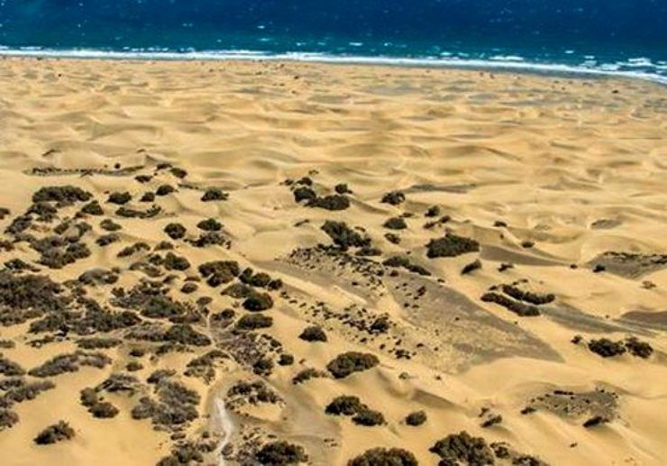 See Maspalomas sand dunes from a helicopter