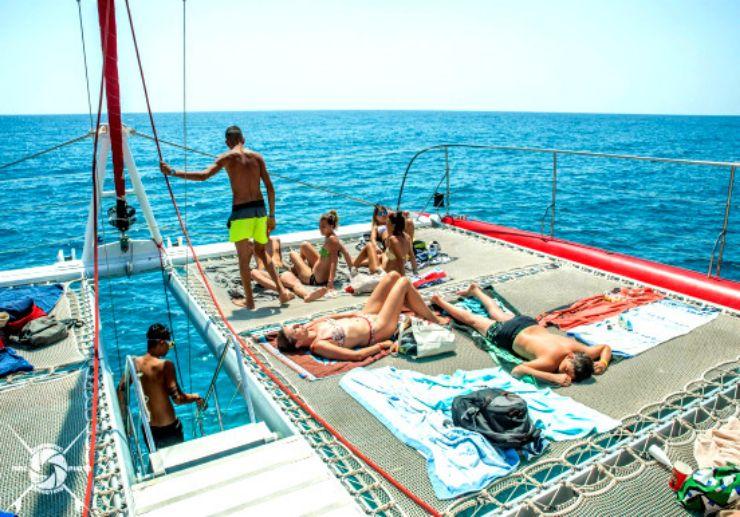 Sunbathing on catamaran Fuerteventura