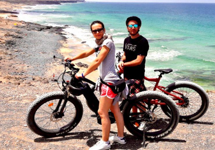 Surf beach at el cotillo electric bike tour