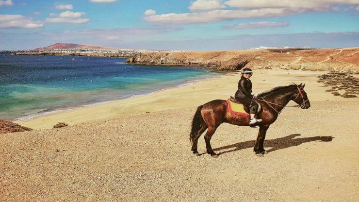 View of Playa Papagayo from horseback in Lanzarote