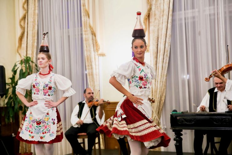 Hungarian folk dance with wine on head