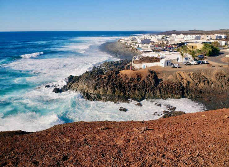 Dramatic coastline of Lanzarote with white traditional houses