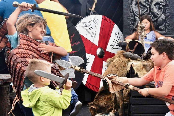 Children viking role play on ragnarok boat trip in Tenerife