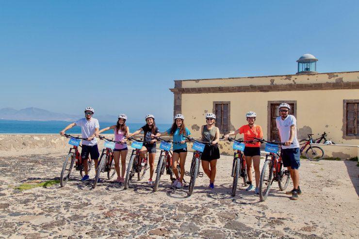 Group of girls on E-bike excursion on Lobos island