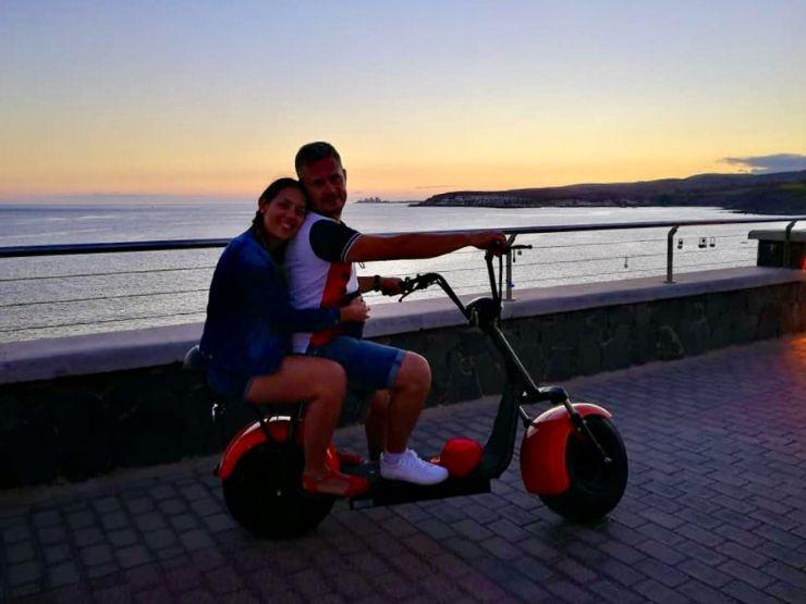 Meloneras sunset e-scooter seafront promenade